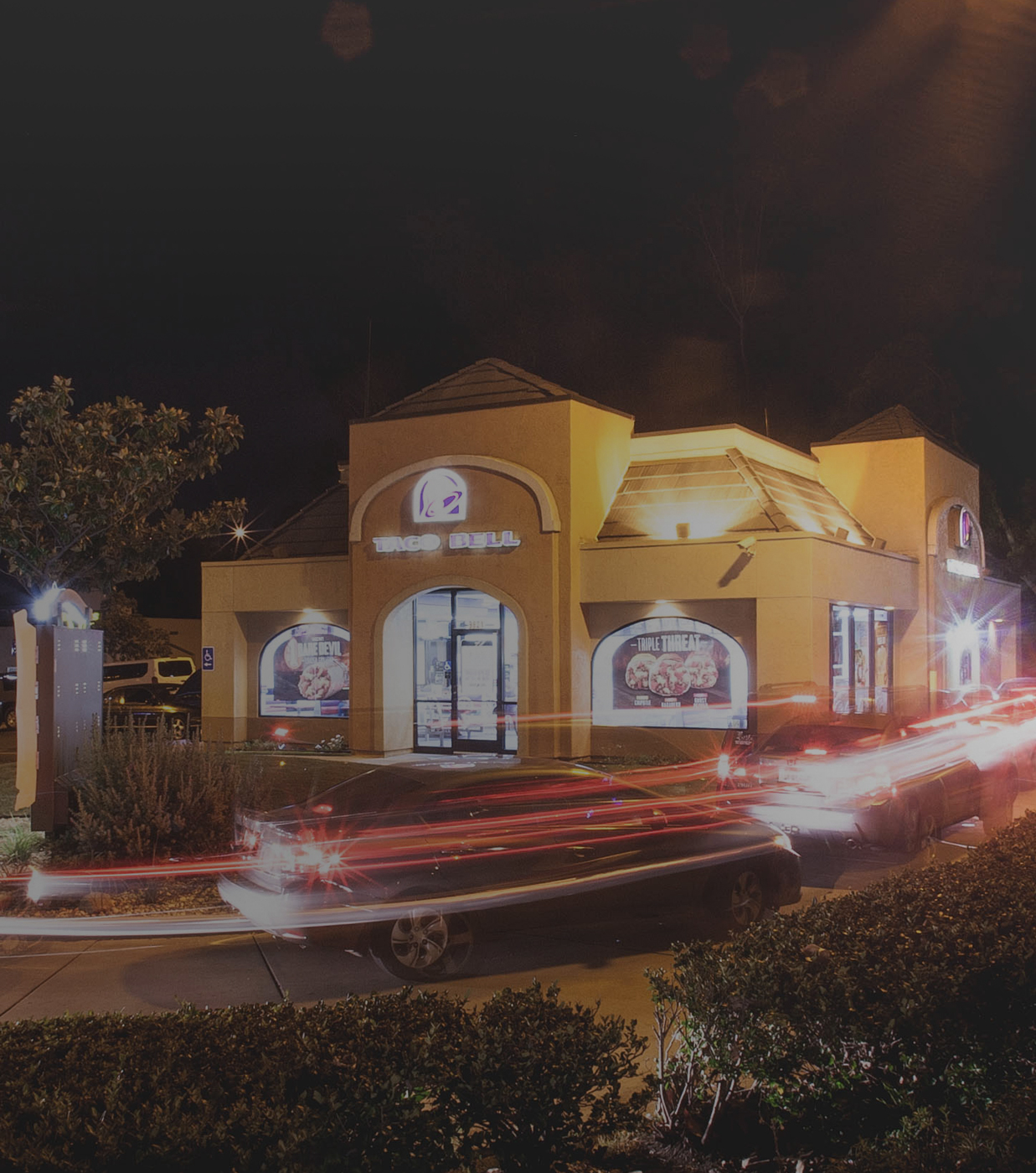 Taco Bell store image at night for the Live Mas campaign